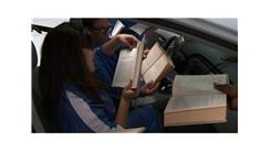 Fastest Time To Read The First Word Of 25 Books In A Prius
