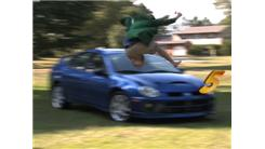 Most Barefoot Car Hood Jumps In 30 Seconds While Wearing A Green Blazer And Holding A Paper Mache Seahorse