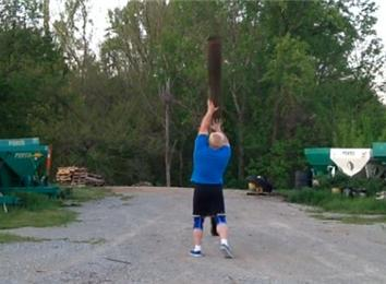 Most Times Flipping A 12-Foot Telephone Pole In One Minute