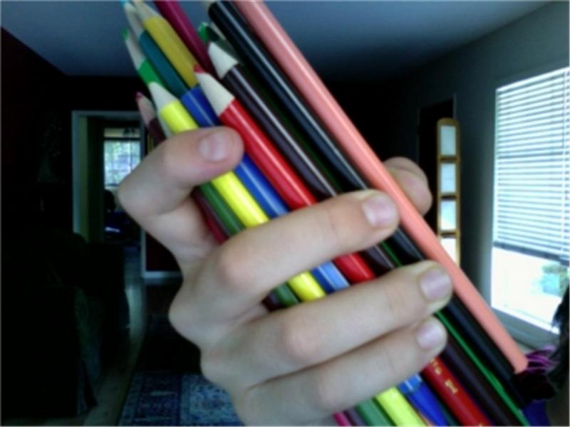 Most Pencils Held In Hand