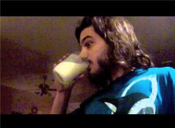 Most Sips Of Eggnog In 30 Seconds While Listening To Neil Diamond