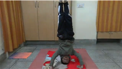 Fastest Time To Count To 200 By Fives While Doing A Headstand