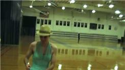 Fastest Cycle Of The Macarena Completed While Wearing A Dress And Fedora Hat