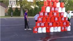 Tallest Five-Gallon Bucket Pyramid On An Outdoor Basketball Court