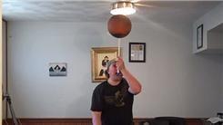 Most Two-Handed Charlier Card Cuts While Spinning A Basketball On A Mouthstick