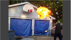 Farthest Distance To Pop A Balloon In A Basketball Rim While Breathing Fire