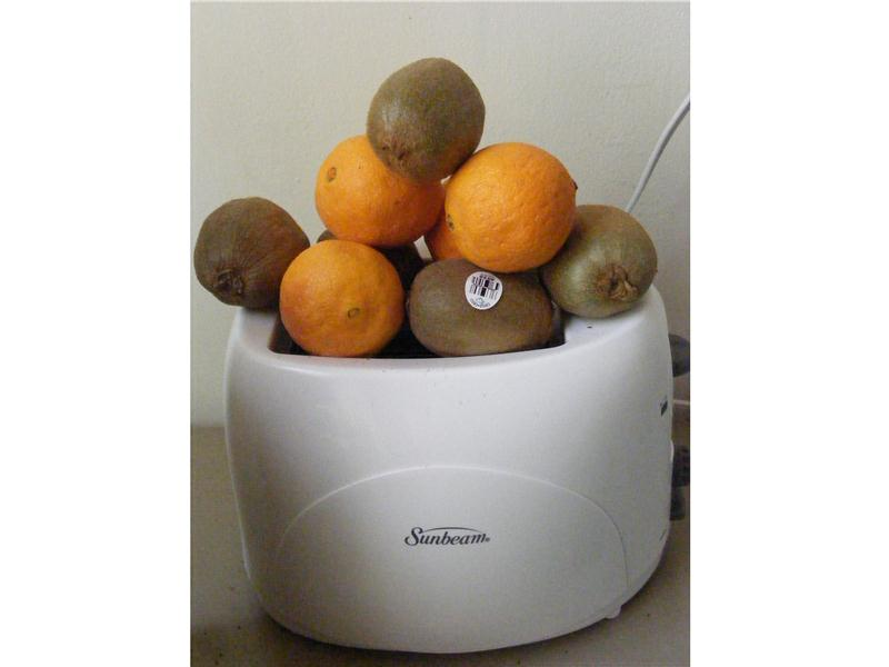 Most Pieces Of Fruit Balanced On A Toaster