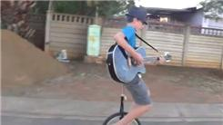 Longest Time Playing Guitar While Riding On A Unicycle