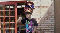 Most Hats Worn While Riding A Unicycle