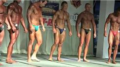 Most Male Body Building Contestants Posing In A Hotel Ballroom At Once
