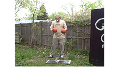 Most Table Tennis Ball Bounces Back And Forth Between Two Mini Basketballs While Standing On A Rola Bola