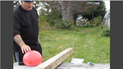 Farthest Distance To Hit A Water-Filled Balloon Using A .22-Caliber Rifle With One Arm