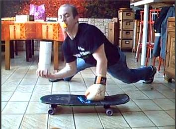 Most One-Armed Push-Ups On A Skateboard While Wearing A Glove, Balancing Three Toilet Paper Rolls And Balancing A Table Tennis Ball On A Spoon Held By Mouth