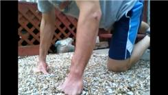 Most Consecutive Knuckle Push-Ups On A Rock Bed