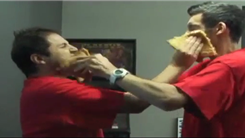 Most Tandem Pizza Slice Face Slaps In 15 Seconds