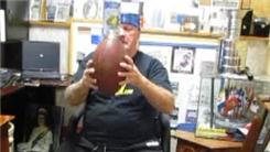Longest Time To Balance A Wine Bottle On Top Of A Football On The Back Of The Hand