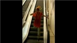 Fastest Time To Run Down An Up Escalator While Wearing An Indian Costume And Holding A Red Balloon
